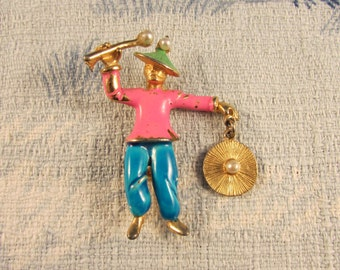 1950s cold painted enamelled oriental figural brooch with stick & gong