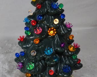 small green and gold lighted ceramic christmas tree vintage holiday multi colored bulbs 2 pieces 11 inches tall