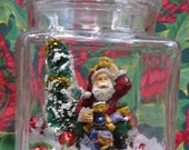 Handmade Christmas Diorama with Vintage Decorations - Santa Claus, Toys, Bottle Brush Tree with Faux Snow in a Glass Container - Retro