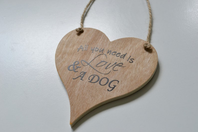 All you need is love and a dog rustic wooden sign vinyl image 0
