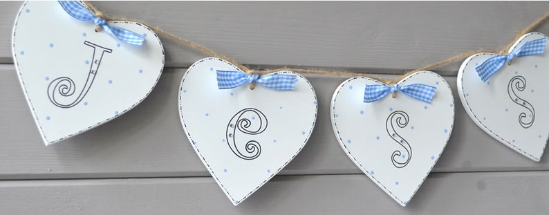 Handpainted wooden heart shaped bunting personalised with any image 0