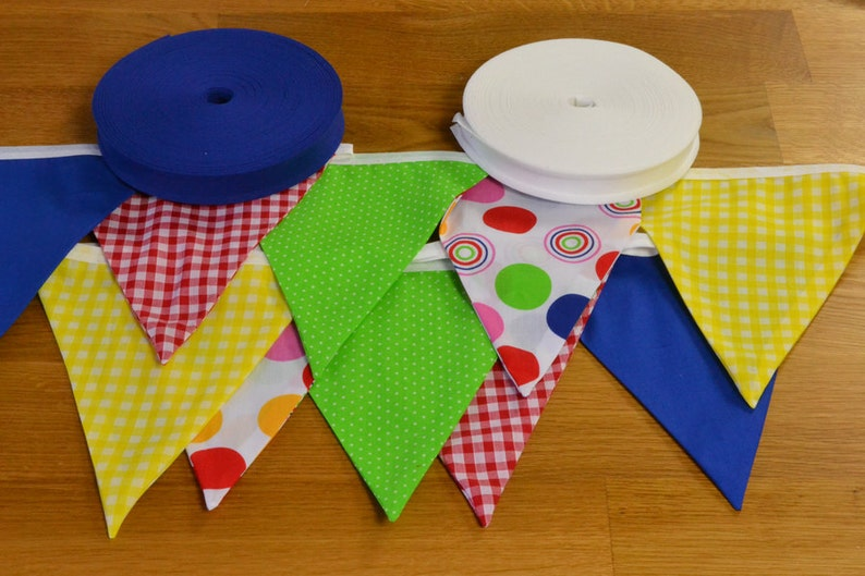 Bright coloured bunting in blue red green and yellow double image 0