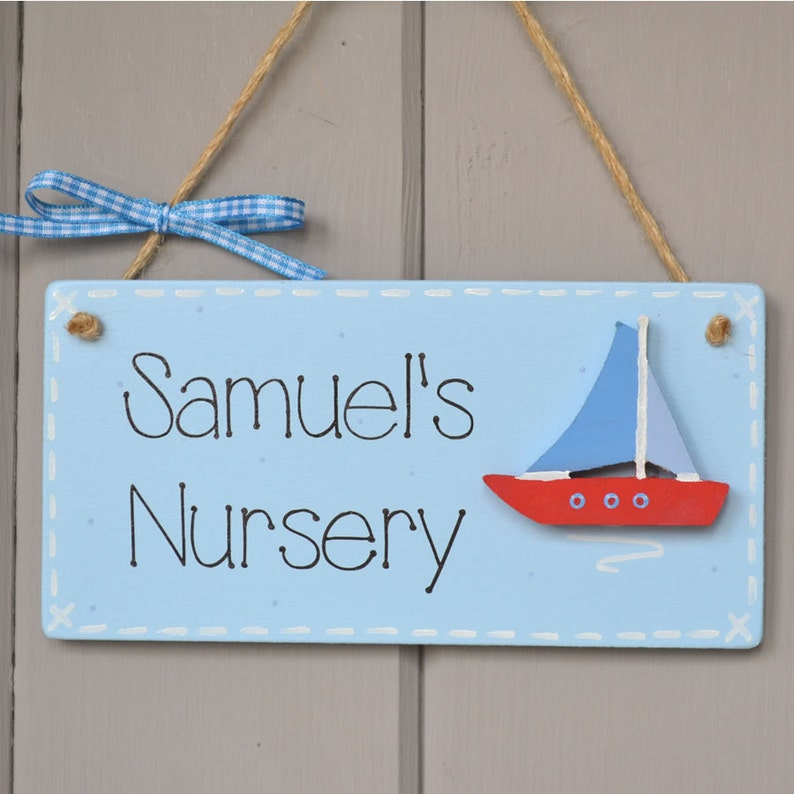 Personalised baby blue nursery door plaque with sailing boat image 0