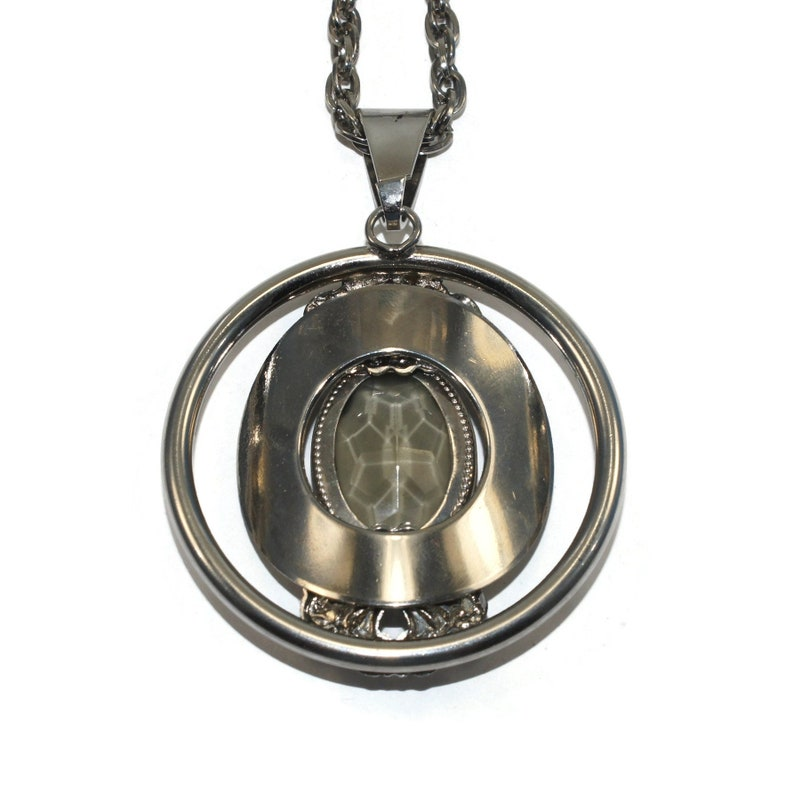 Vintage Southwestern Style Round Silver Tone Pendant with Faceted Faux Smoky Topaz on 24 Inch Silver Tone Chain with Spring Ring Clasp.