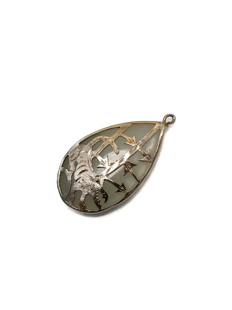 Beautiful Vintage Teardrop Shaped Light Jade Pendant with 10K Gold Overlay Cut Out Design of a Chinese Zodiac Tiger.