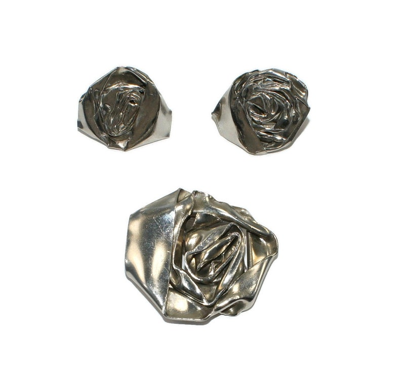 Vintage Avant Garde Silver Tone Rose Flower Brooch and Matching Clip on Earrings.