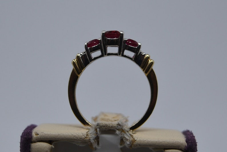Size 6. Z240 Vintage 10K Yellow Gold Ring with Created Rubies