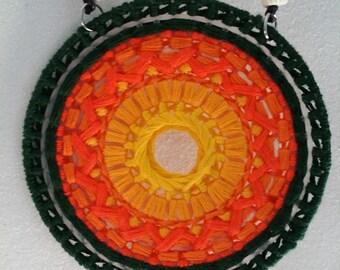 orange starburst pendant