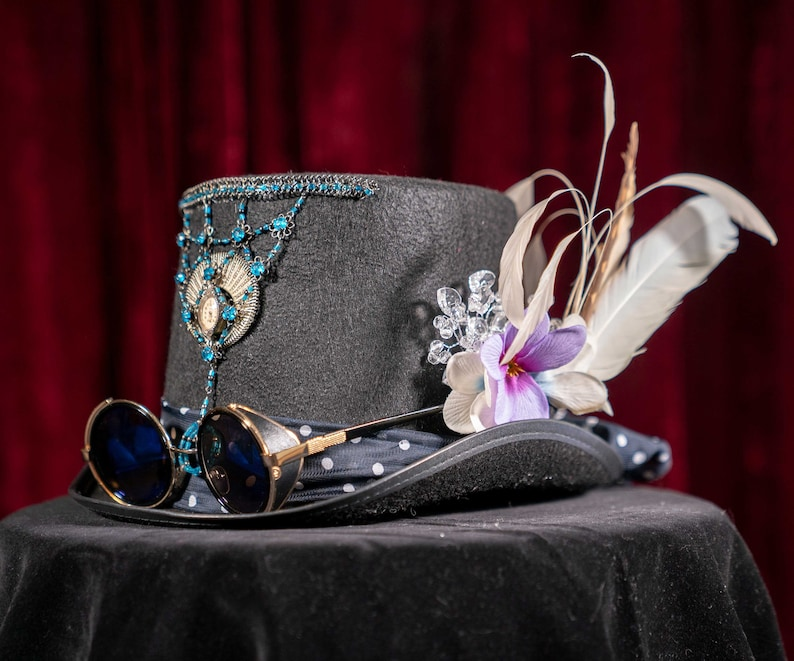 Elegant top hat with steampunk glasses feathers and cloth image 0