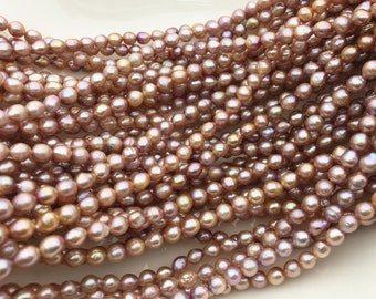 Dyed Chinese freshwater banded rice pearls