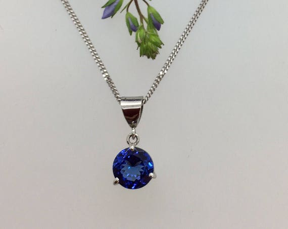 Tanzanite Pendant - 18ct White Gold - Douglas Hughes Design set with a Sparkling Diamond Cut Tanzanite