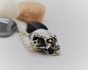 Handmade Silver Skull Necklace With Rose Gold Eyes, Douglas Hughes Design