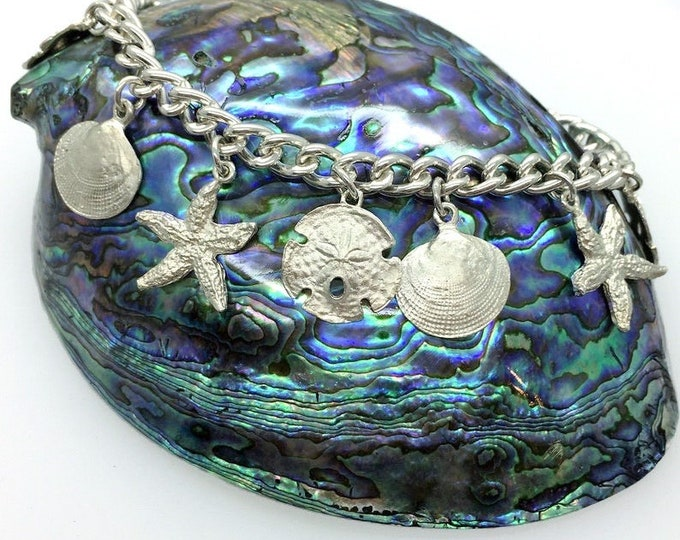 Silver Seashell Charm Bracelet - Handmade Douglas Hughes. Silver Seashell, Seashell Jewellery, Seashell Charms, Silver Sea Shell, Sea Charm