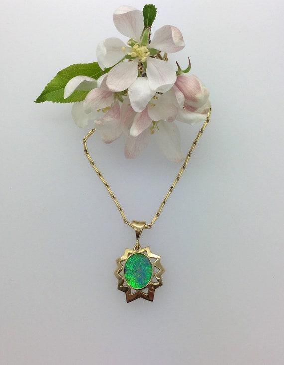 Opal Pendant - 18ct Yellow Gold - Douglas Hughes Star Burst Design set with a Vivid Peacock Blue/Green Australian Opal Doublet