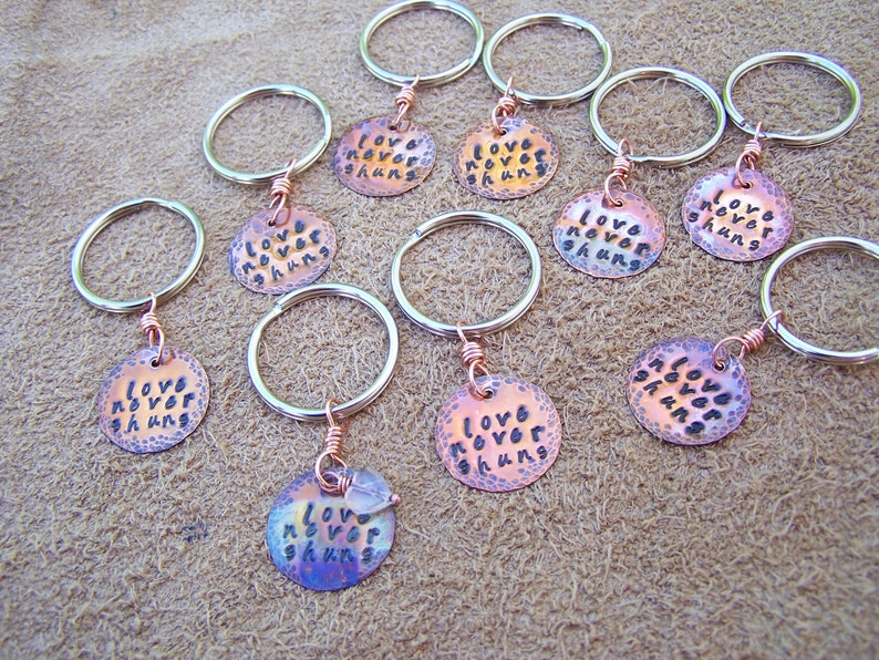 stamped copper disc charms in antiqued or flame colored natural finish Custom Stamped Medallions For Keychains And Pendants hammered