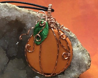 Antiqued copper wire wrapped orange polymer clay pumpkin pendant