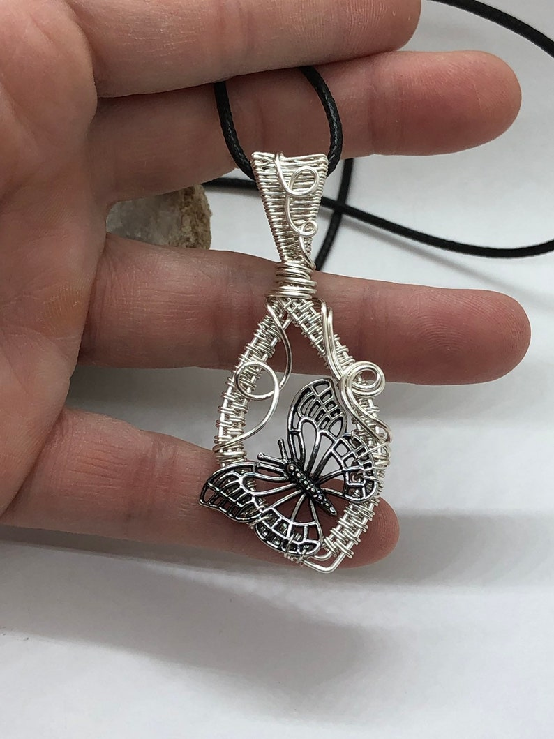 Silver colored wire wrapped butterfly pendant