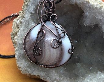 Antiqued copper wire wrapped shiva shell pumpkin pendant