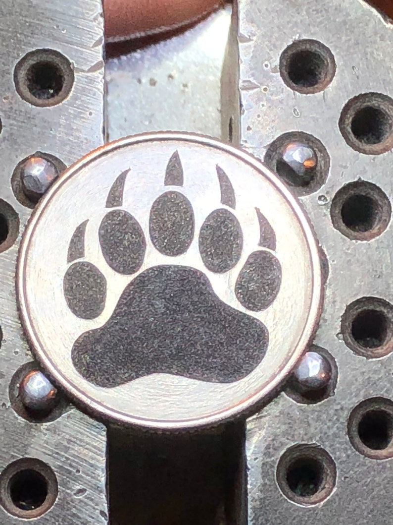 Hand carved Quarter with Bear paw design hobo coin