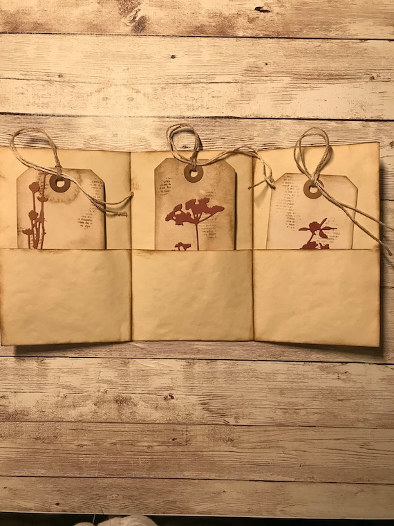 rubber stamping and wild flower die cut placed  in a tea dyed folder Coffee dyed shipping tags distressed with ink