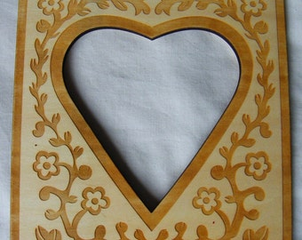 Wooden Frame with heart shaped opening made especially for me in France to use with my counted cross stitch chart Little Hearts and Flowers.