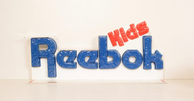 5b2453c0f0c14 Vintage Reebok Kids 70s 80s Store Display Plastic Shelves for Retro Sneakers