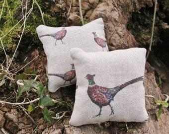 2 pheasant print lavender filled bags .