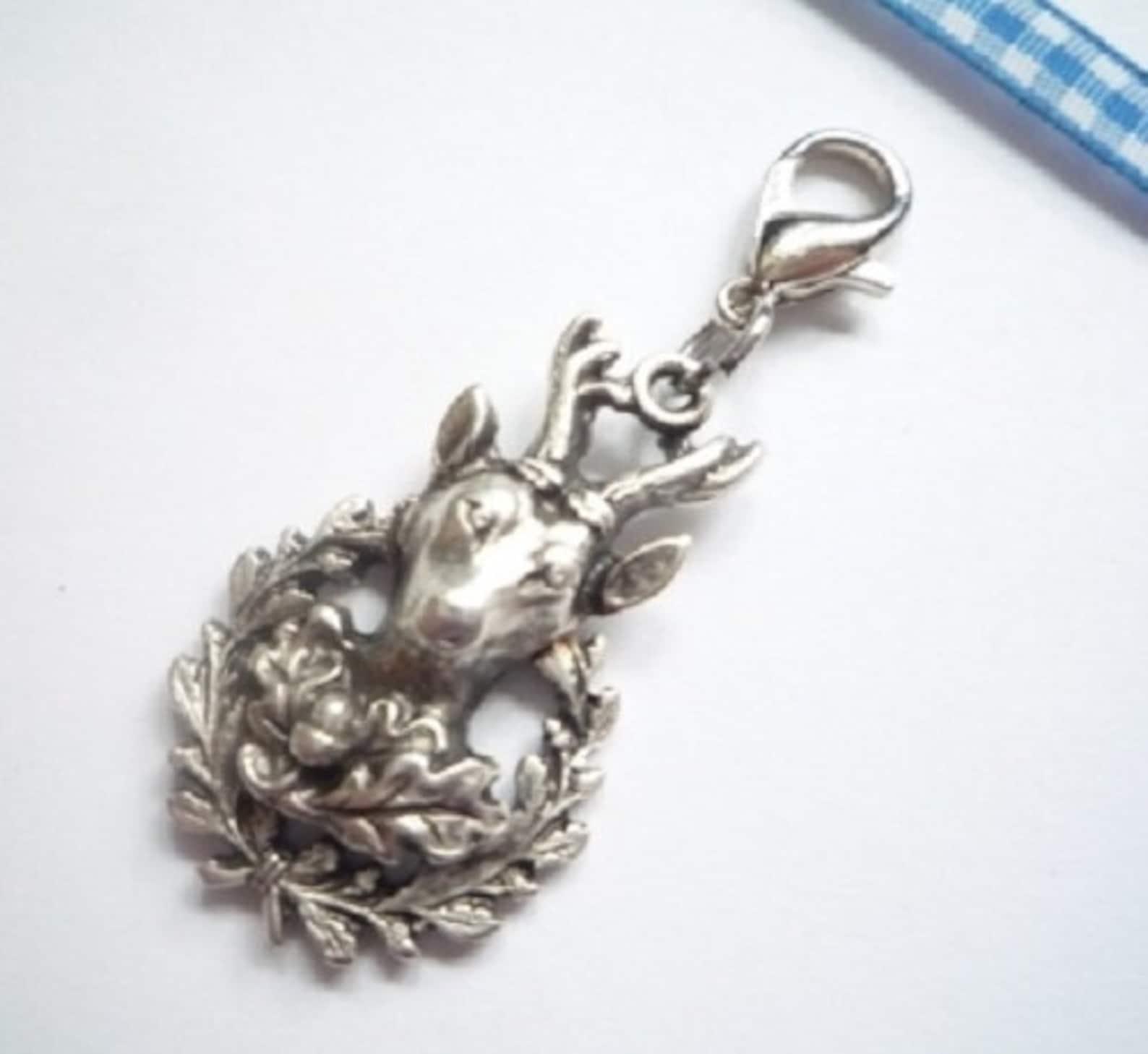 https://www.etsy.com/listing/625181401/charivari-pendant-deer-head-with-oak