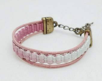 Pink-mauve and white bracelet created with a vintage, silk kumihimo haori tie and leather cording