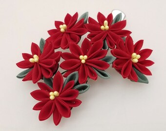 Large, red poinsettia Kanzashi Christmas or holiday hair clip