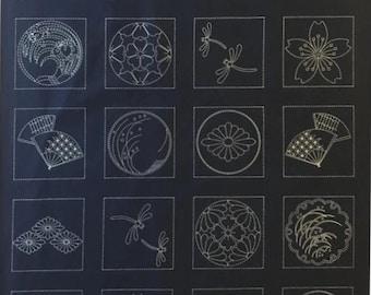 Sashiko pre-printed wash-away pattern sampler panel - Japanese crests and traditional designs on dark navy