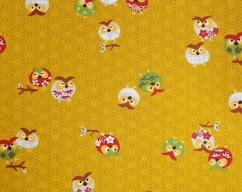 Yamaoka Japan colorful owls over ocher goldenrod hued cotton fabric