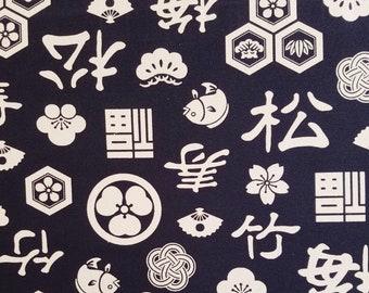 Kokka Japan #8 weight cotton duck canvas - off-white traditional motifs over deep navy indigo -celebration pattern