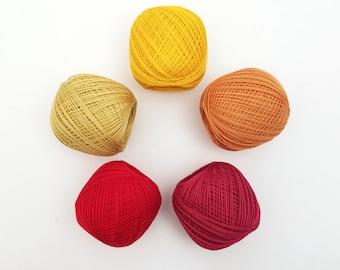 Thin weight sashiko thread- red, orange and yellow hued colors - 80 meter ball