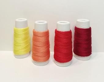 Lecien Cosmo Hidamari sashiko thread - Yellow and Red hued solid colors - 30 meter skein