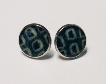 Silver toned stainless steel stud earrings with deep green and white colored shibori kimono fabric
