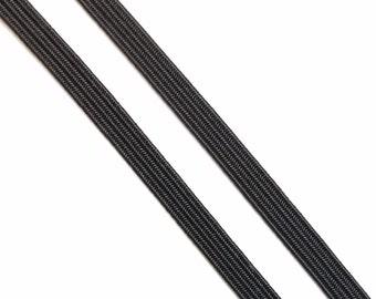 Vintage, .25 inch wide black braided elastic - by the yard