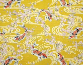 Hokkoh Japan dobby cotton koi, ripples and sakura over Goldenrod ocher hue
