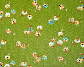 Yamaoka Japan colorful owls over green cotton fabric