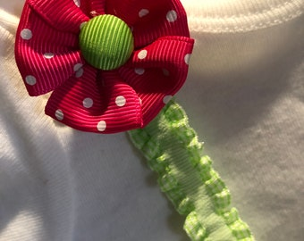 Hot Pink poka-dot fabric flower on ruffled elastic will keep track of your Pacifier/Binlky. Nickel free clip