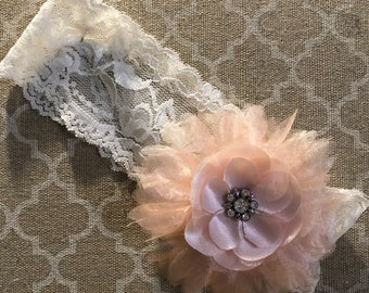 Shabby Chic Baby headband, wider lace with a light peach flower. This is the perfect headband for a photo shoot or simply everyday wear.