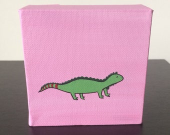 """Iguana 4""""x4"""" acrylic painting on canvas, over a pink background"""