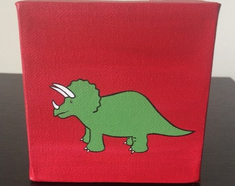 """Triceratops 4""""x4"""" acrylic painting on canvas, green dinosaur over a red background"""