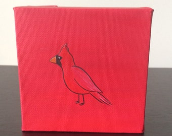 """Cardinal, 4""""x4"""" acrylic painting over a red background"""