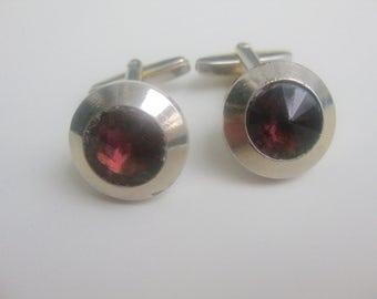 Old, wine-red glass cufflinks