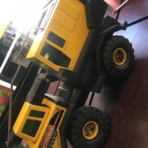 Vintage Toy Yellow Metal Flatbed Truck Rubber Wheels