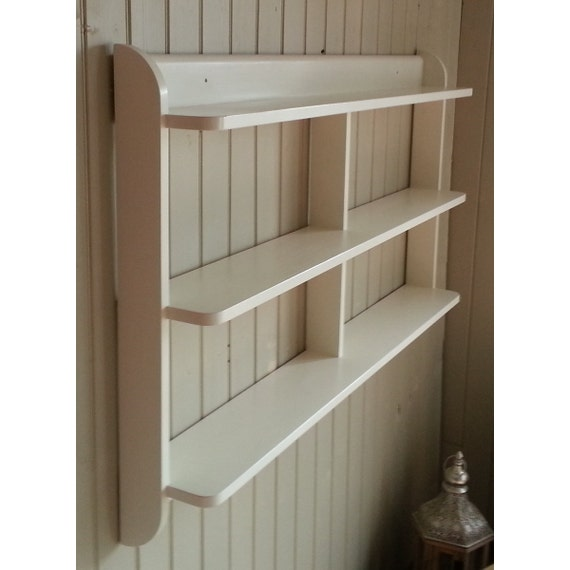Wide wall mounted open back shelf unit. Painted kitchen shelves or dvd and  paperback book shelves.