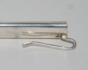 Sterling silver lapel flower holder, or a boutonnière holder although some people call it a tussy mussy or posy holder but it's not.