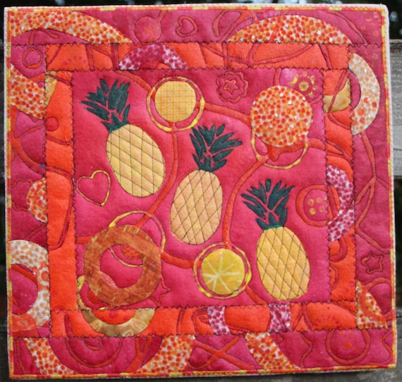 Tumbling Pineapples Quilted Acrylic in Orange and Red