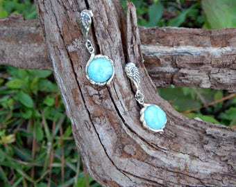 Top Quality Larimar Edged With Sterling Silver Dangle From a Pair of Beautiful Angle Wings